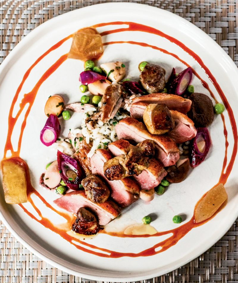 ART OF THE PLATE: Buttery duck breast is seared on an iron skillet and served with Nostrale rice, foie gras, vegetables, and Bradford watermelon molasses.