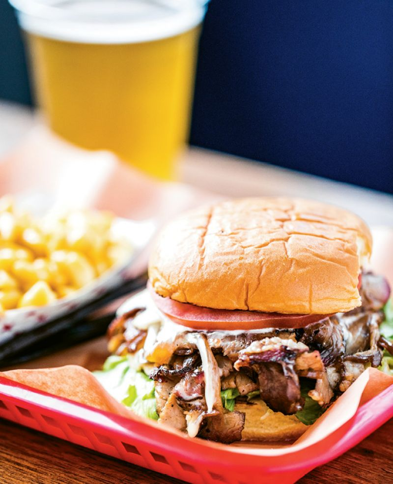 BETTER THAN PHILLY: A riff on the Philly cheesesteak, Rodney's ribeye sandwich is piled high with thinly sliced meat, melted cheese, and caramelized onions.