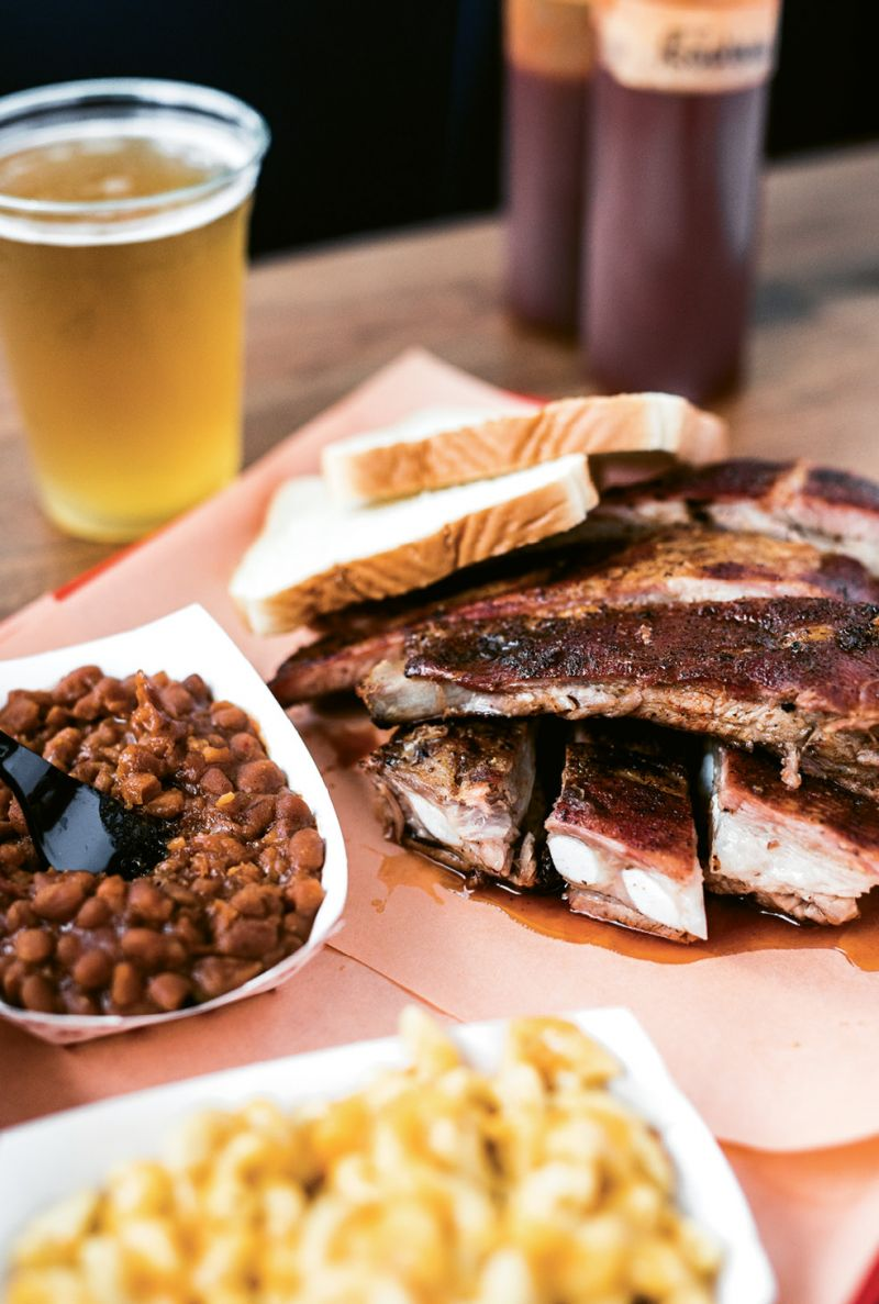 A plate of smoky ribs, sugary baked beans, and mac-n-cheese.