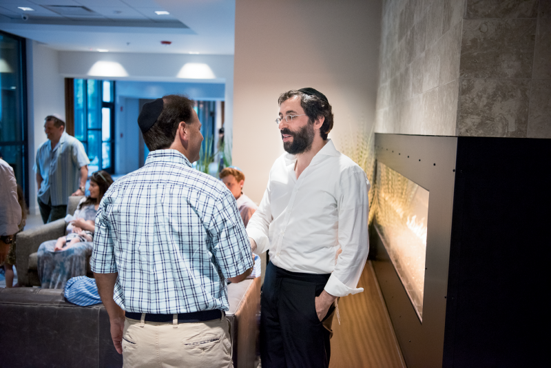 Rabbi Yossi Refson (right) in The Center for Jewish Life's comfy common area