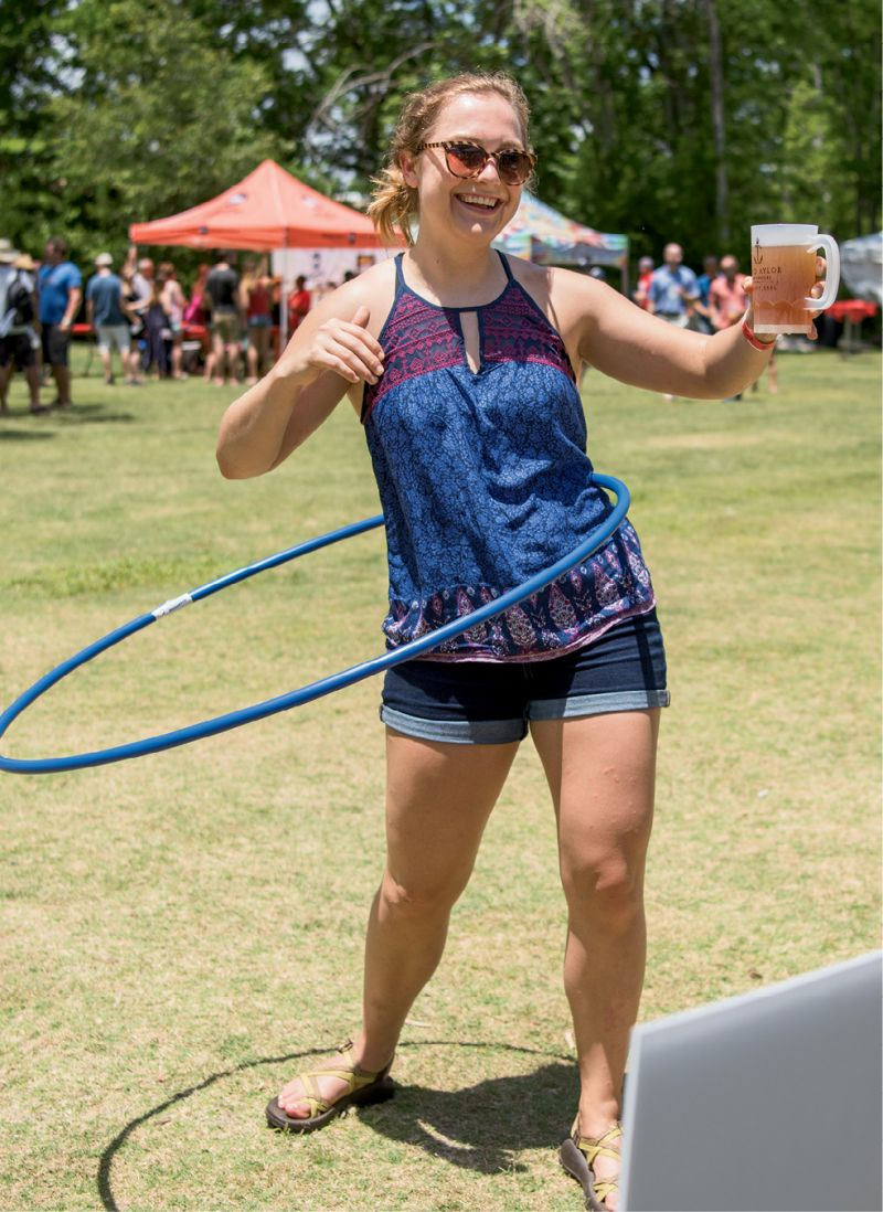 Balancing a mug of beer while hula-hooping during the hula-hooping competition was no easy feat.