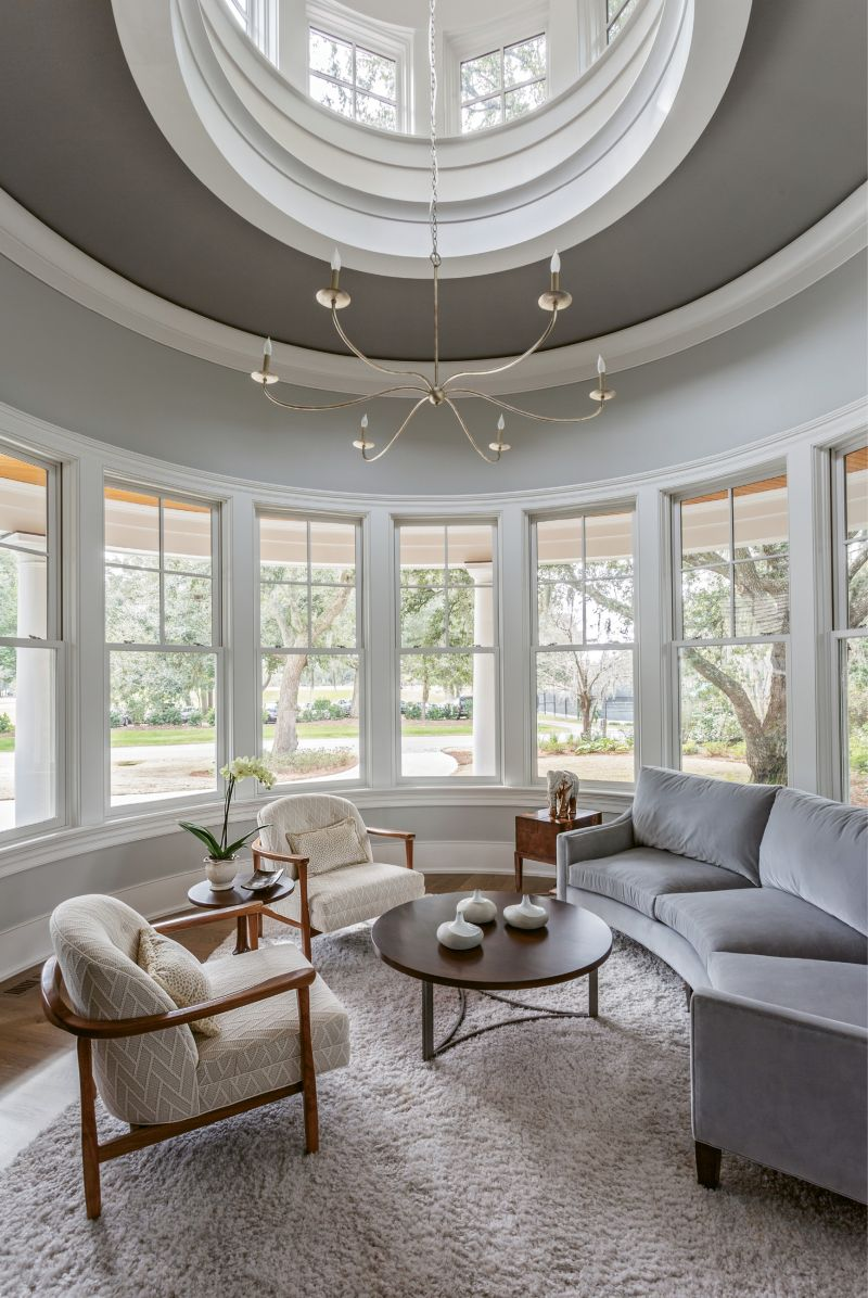 """SIT BACK & RELAX: """"When we were furnishing the home, the focus was always on how the spaces would be used,"""" says Theresa T. Morton of Studio TTM, one of the project's interior designers. Copious seating areas, such as the circular sitting room and upstairs den, boast a multitude of comfy chairs and oversized sofas from Precedent and Sherrill in a collection of subtle, patterned fabrics that complement the exterior views without detracting from their splendor."""
