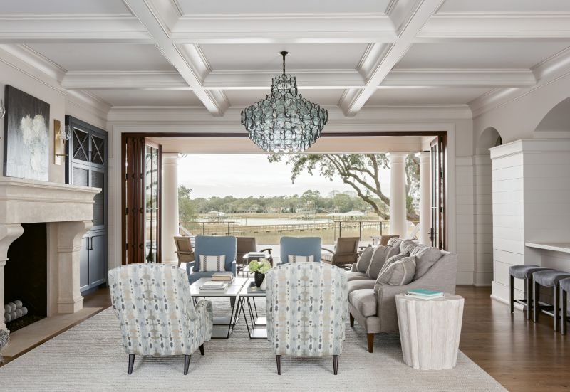 CREEKSIDE CHARMS: A wall of windows opens to bring the home's indoor and outdoor living spaces together, offering expansive views of Wappoo Creek from the front of the home to the back.