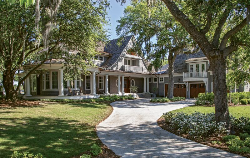 """MADE IN THE SHADE: With """"the Kiawah look"""" in mind, Suzie and Mark Dajani built their dream home—a blend of Northeastern shingle-style architecture with classic Southern touches—on James Island."""