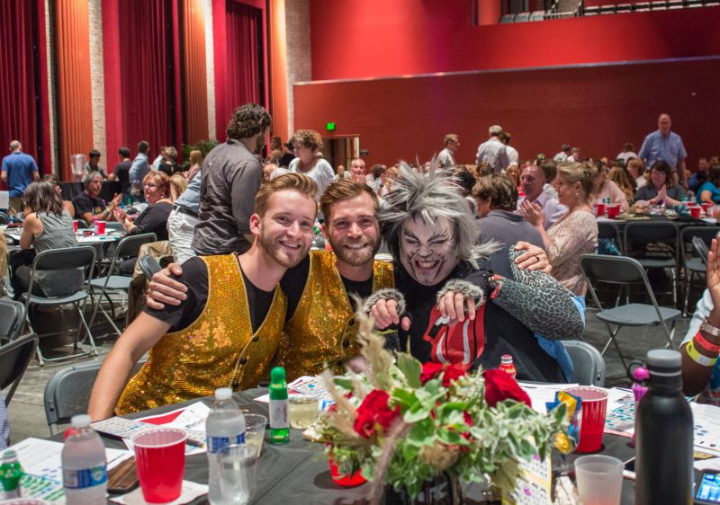 Mike Morris, Tim Brown, and Patrick Mitchell, dressed as a character from Cats