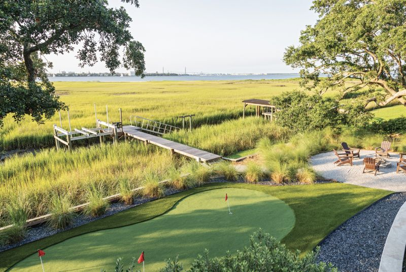 FORE FUN: Cade Miller with Graceful Gardens designed the landscape, including a putting green for Paul, a dedicated golfer.