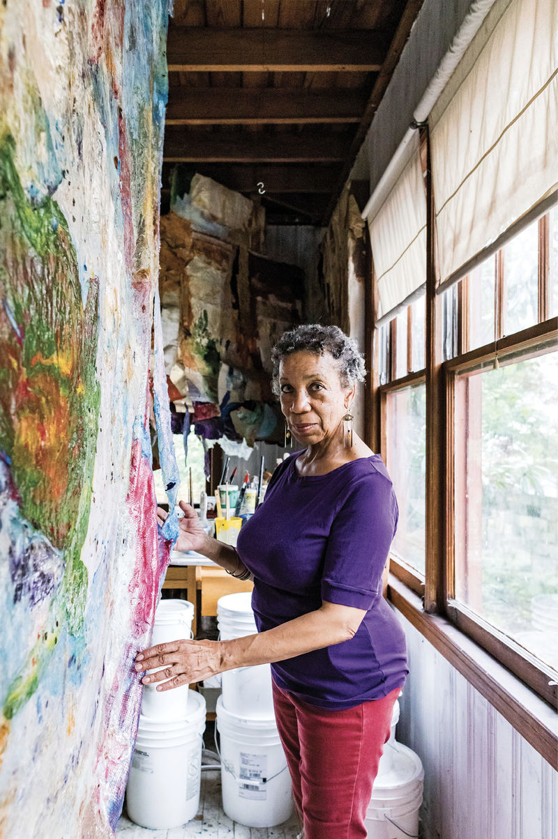 """Artist Suzanne Jackson in her home studio in the Starland District; a retrospective of her work titled """"Five Decades"""" was featured last year at the Telfair Museum's Jepson Center. Her recent paintings are sculptural layers of acrylic—no canvas, no frame."""