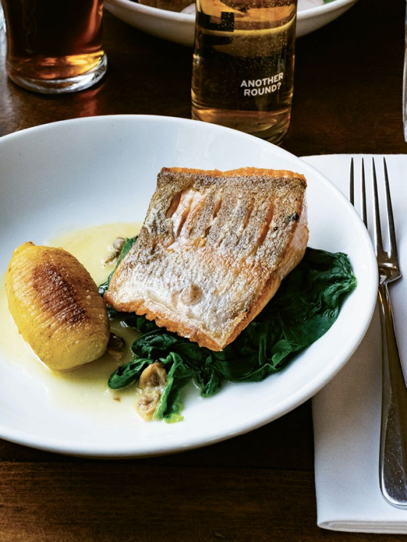 Pan-fried trout with Charlotte potato, sauteed spinach, and cockles at The Thomas Cubitt
