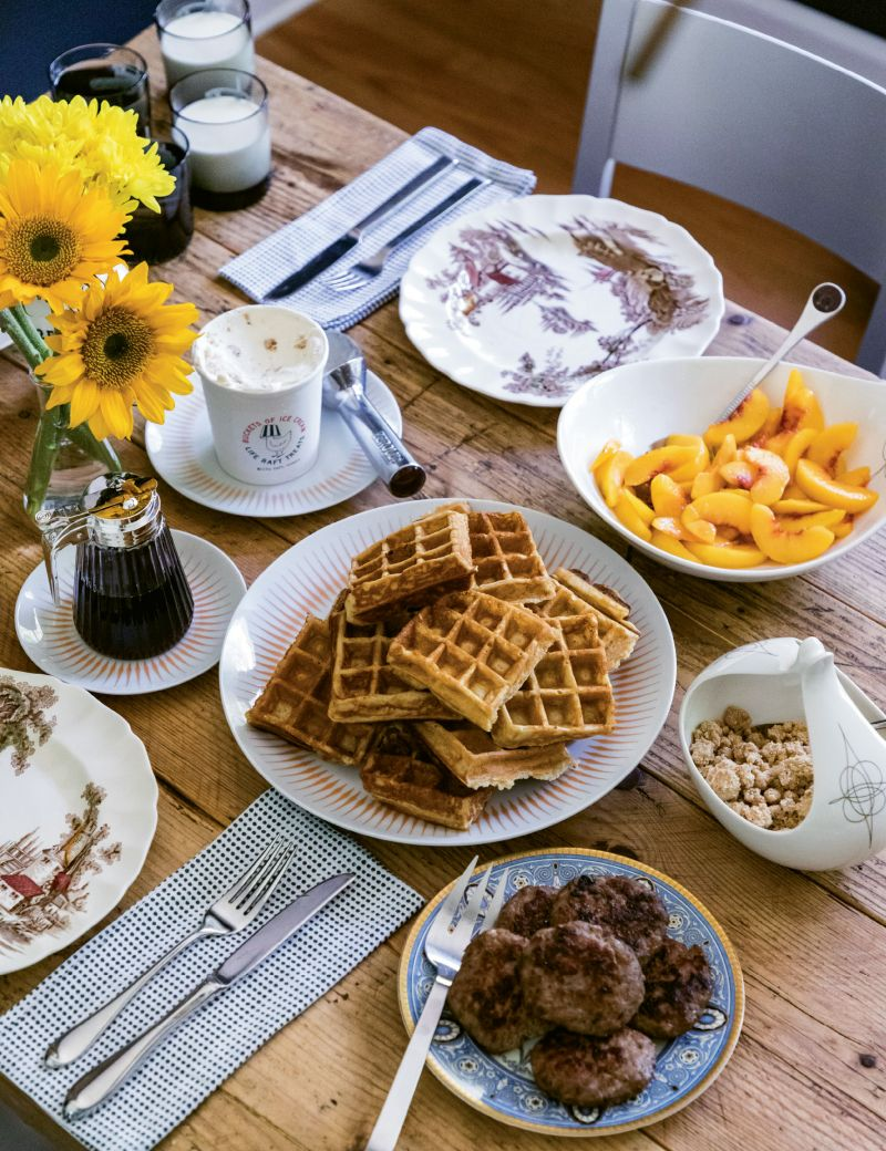 Breakfast at Harmon Manor (clockwise): local peaches, brown butter crumble, Storey Farms sausage patties, Anson Mills rice flour waffles, maple cheesecake ice cream