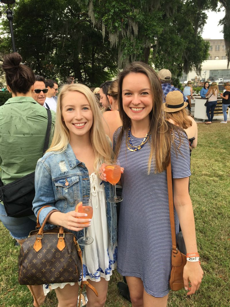 Anne Goforth and Therese Spaseff enjoy cocktails on the lawn.
