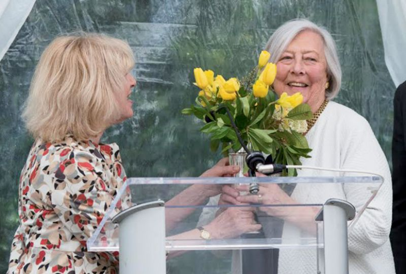 Paula Robison presenting flowers and the award to Evelyn McGee