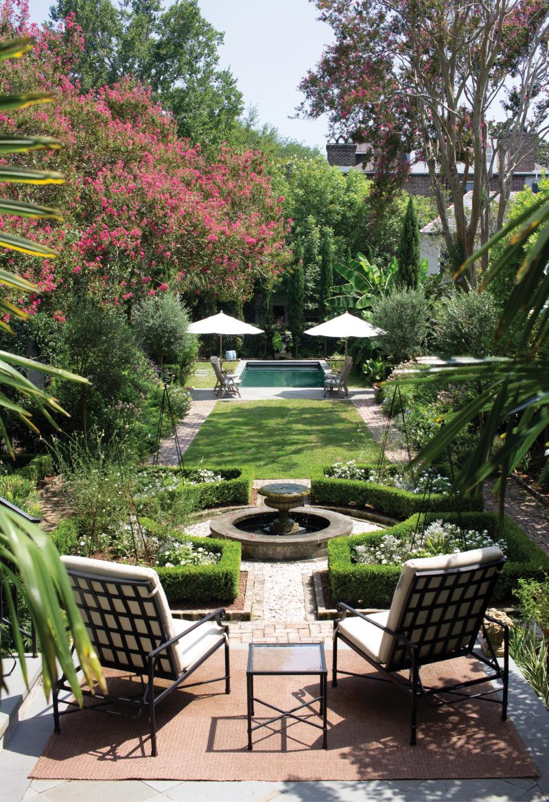 """High Impact: """"The Massamillos' house is elevated above the garden—not so high that it's intimidating, but just enough that one gets a lovely, long perspective to the back garden from many rooms in the house,"""" says Wertimer. A bluestone patio steps down into a French parterre, where Susan plays with a changing array of white annuals. Last year, she combined impatiens and artemisia, then trained sweet peas to climb up tuteurs, with gaura popping up here and there."""