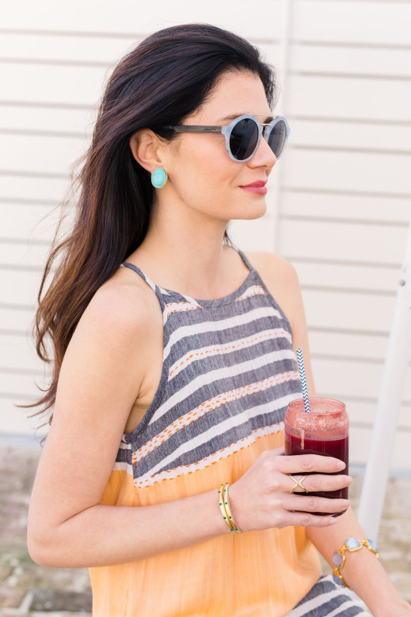 """Lula Soul """"Mykonos"""" maxi dress, $128 at lori+lulu; Johnny Fly Co. wood sunglasses with polarized """"blue fog"""" lenses, $120 at Julep; estate scarab earrings, $50, and Elizabeth and James gold-plate and agate """"Georgia"""" cuff bracelets, $175 each, and gold-plate """"Windrose"""" ring, $95, all at Croghan's Jewel Box; Julie Vos 24K gold-plate """"Catalina"""" bracelet, $375 at Abide A While Garden Boutique"""