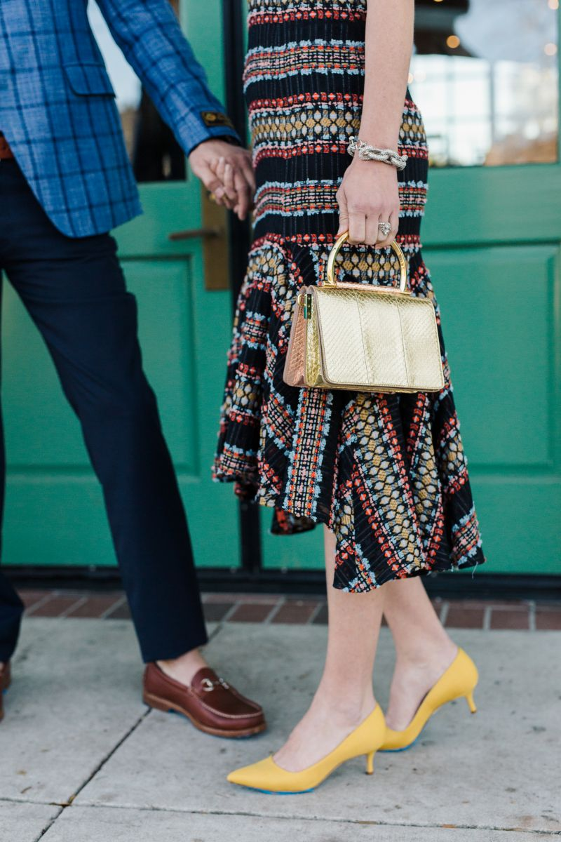 "On Anna: Kimora Lee Simmons Marrakesh lace ""Bella"" dress, $1,395 at Berlin's for Women, chunky link rhinestone bracelet, $49 at Lulu Burgess; Manolo Blahnik Classic ""BB"" pump, price upon request at RTW; Salvatore Ferragamo mini ""Gancini"" top-handle bag, $2,300 at Gwynn's of Mount Pleasant. On Mike: Ike Behar ""Niles"" wool-silk-linen blend sport coat, $1,095 at Ike Behar; Brunello Cucinelli 5 Pocket Twill pant, $695 at Gwynn's of Mount Pleasant; Handsewn Company for Grady Ervin & Co. loafer, $245 at Grady Ervin & Co."