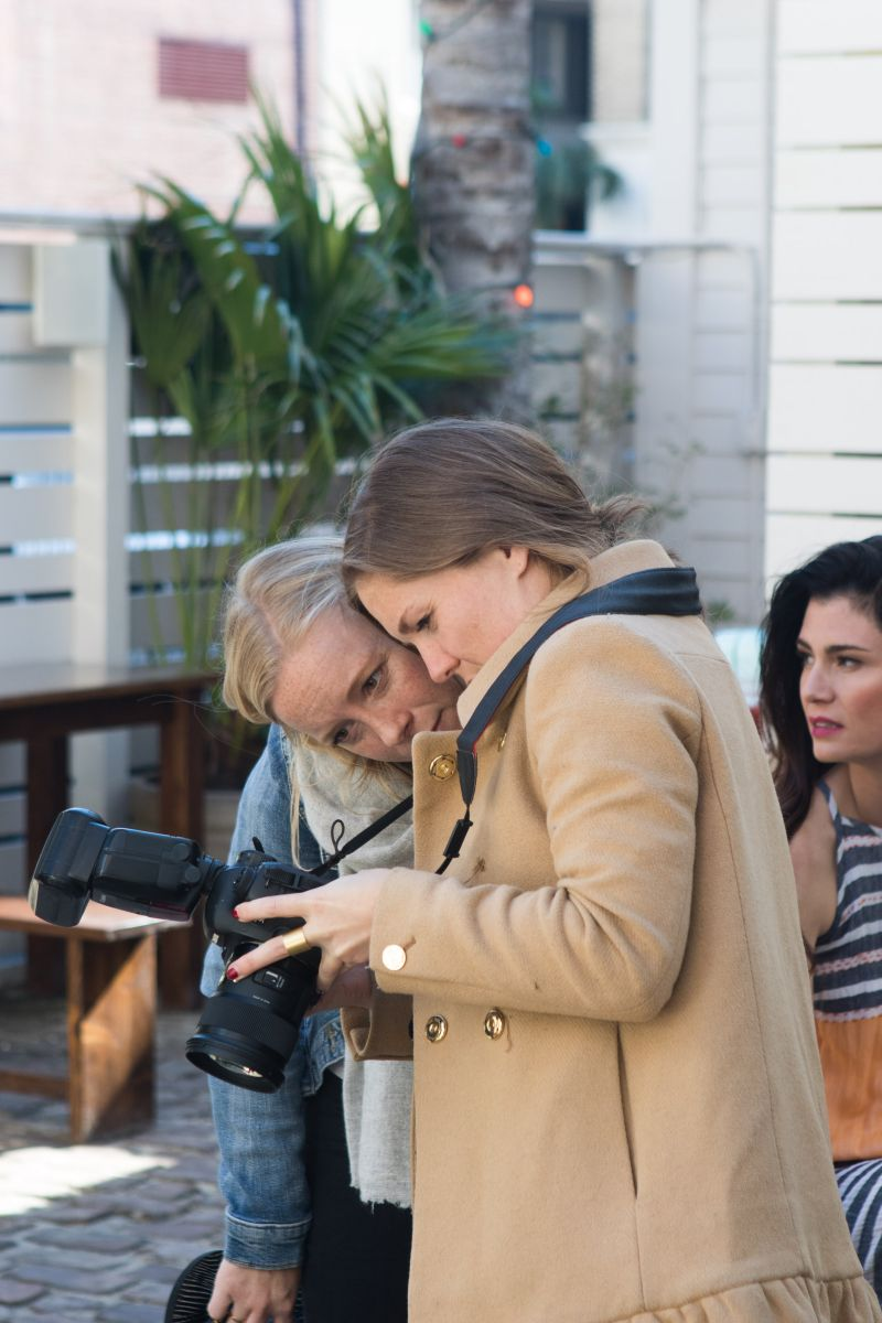 Stylist Quinn Sherman and Anne Jervey review shots.