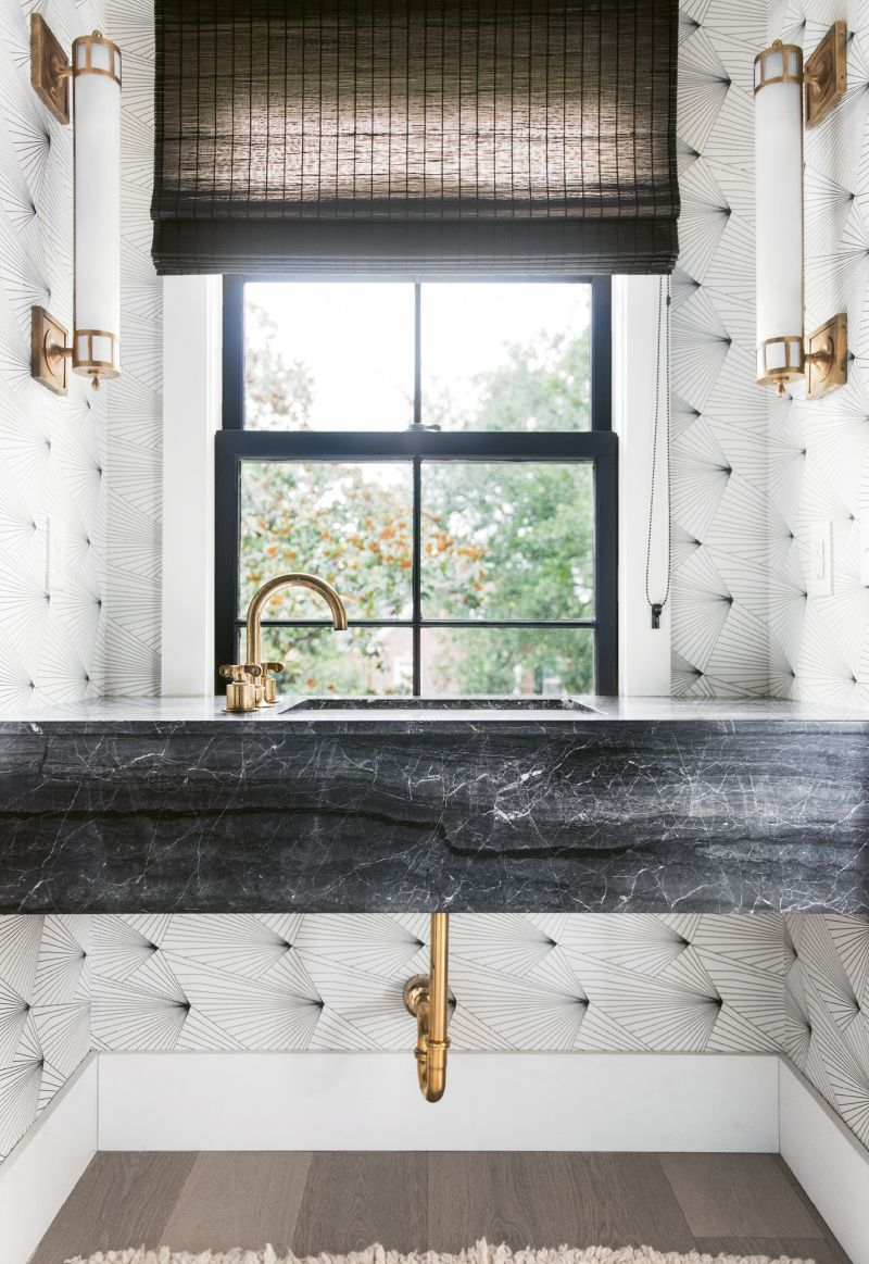 """This powder-room isn't upholstered, it's a trompe-l'œil effect created by Erika Wakerly """"Fan"""" wallpaper."""