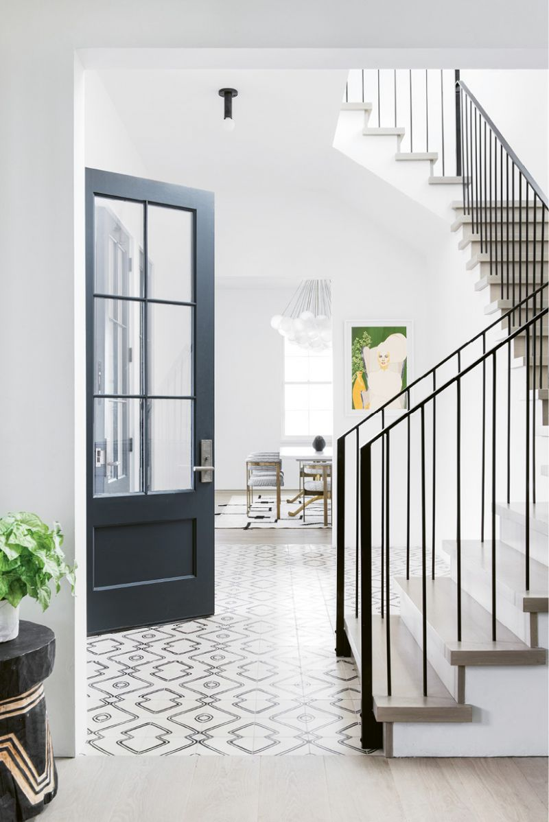"""In this informal entry, Exquisite Surfaces """"Commune"""" cement tile in the """"Navajo Zebra"""" pattern sets a playful tone. """"It's a lively welcome to the house via our side doors, which most friends and family use,"""" Molly notes."""