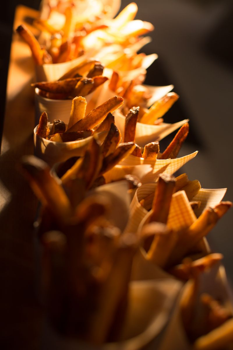 """A fun bite inspired by The Village: hand cut """"fry cones."""""""