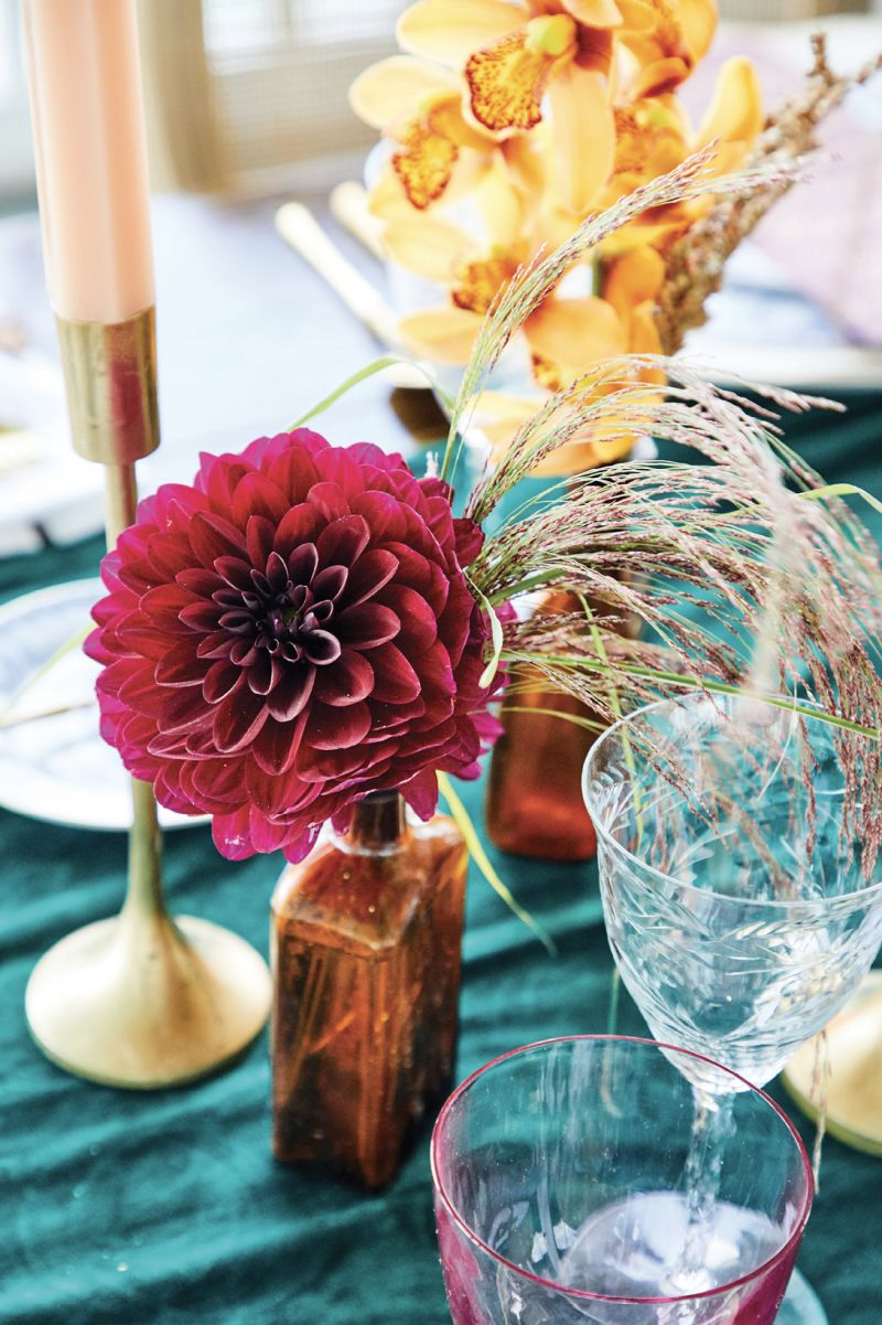 Special touches: small vintage bottles filled with blooms and grasses