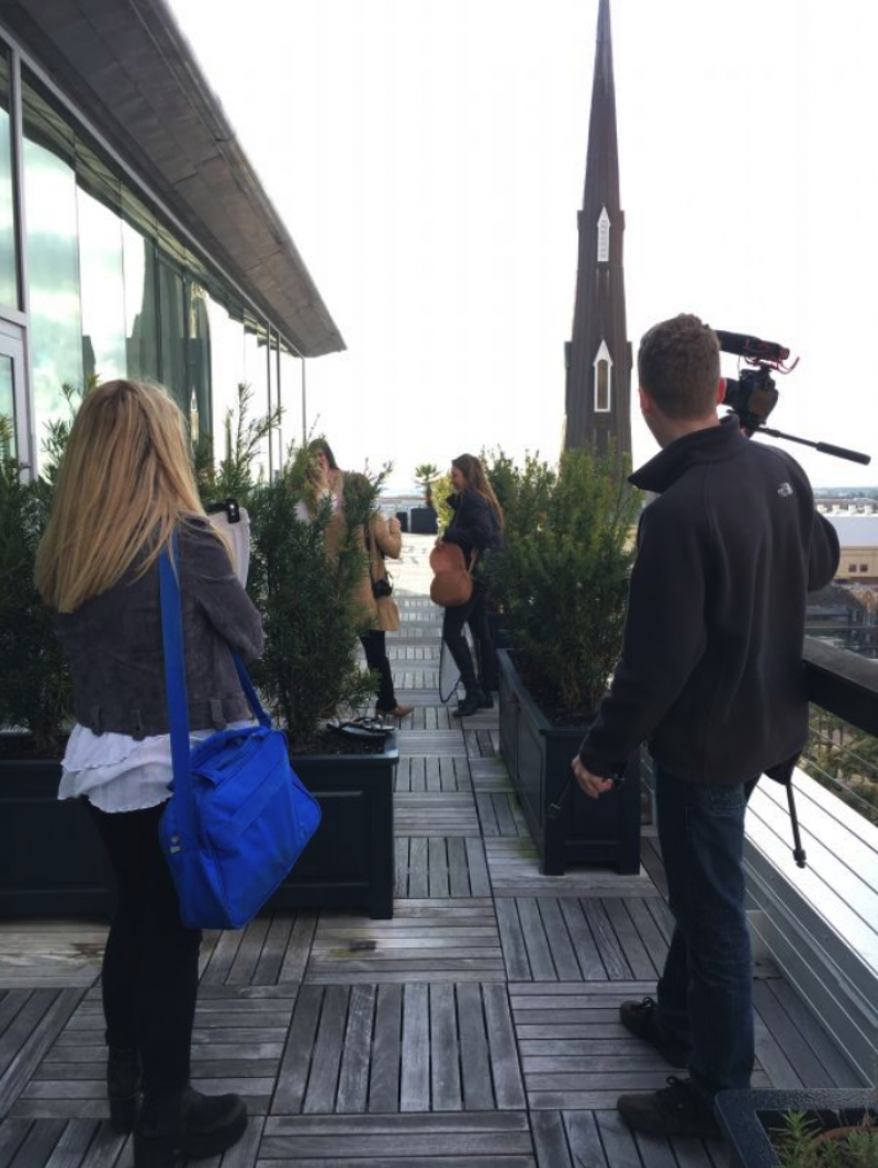 The crew heads up to the Dewberry rooftop for the first shot of the day.