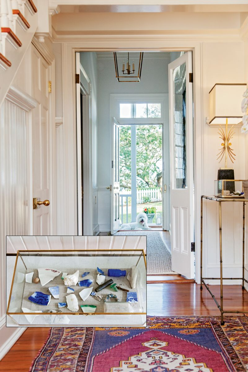 A central hall bisects the original farmhouse, which is flanked by symmetrical additions from two previous owners. A collection of pottery shards and glass (below) that Shannon and her brother unearthed on the property as children is displayed in the foyer.