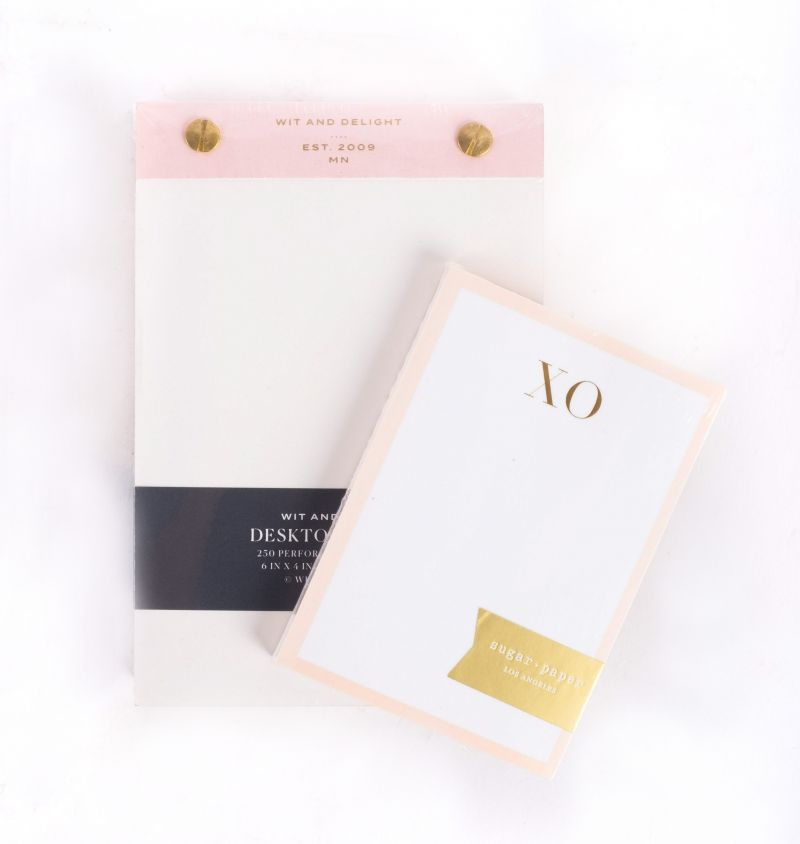 "Wit & Delight desktop notepad, $13, and Sugar Paper LA mini ""XO"" notepad, $10, both available at Mac & Murphy"