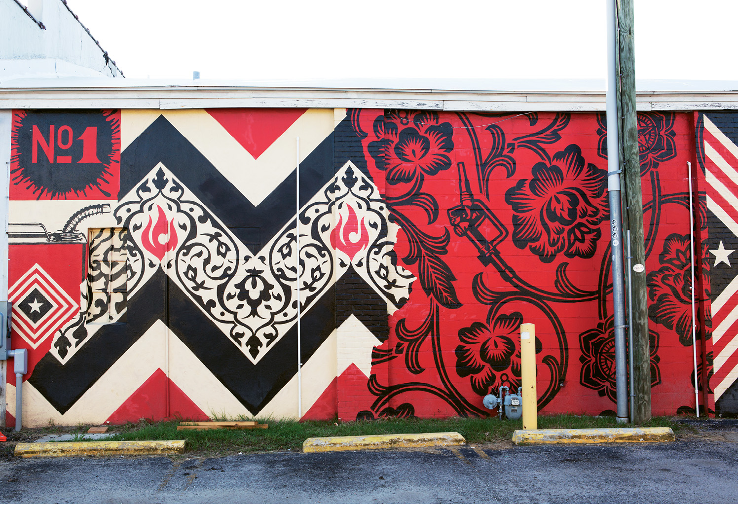 "Power & Glory  by Shepard Fairey  May 2014 - Across the driveway from The Daily and High Wire Distilling Co. (656 King St.). In conjunction with his 2014 Halsey Institute of Contemporary Art show, ""The Insistent Image: Recurring Motifs in the Art of Shepard Fairey and Jasper Johns,"" the Charleston native and artist of ""Andre the Giant has a posse"" and ""Obey"" fame received permission to install a series of large-scale public murals on private buildings downtown."