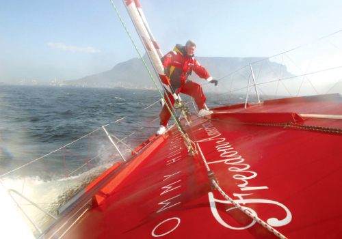 Brad sails off the coast of South Africa just beyond Cape Town's prominent Table Mountain. Photographs by Billy Black.